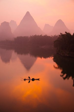 Fisherman on the Li River by Bill Coster